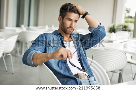 Handsome man touching his hair  - stock photo