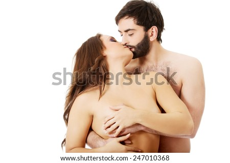 Handsome man touching woman's breast and kissing her. - stock photo