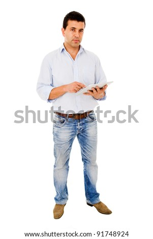 Handsome man using a tablet computer against a white background - stock photo
