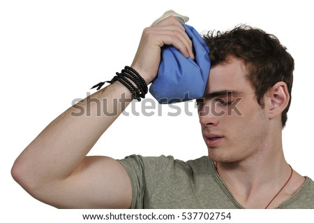 Handsome man using an ice pack for a headache