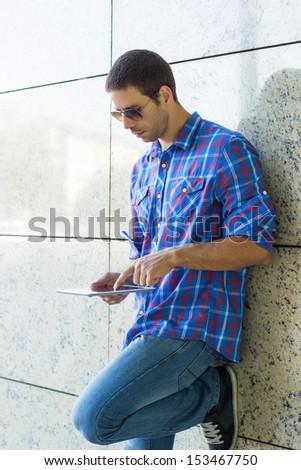 Handsome man using digital tablet  - stock photo