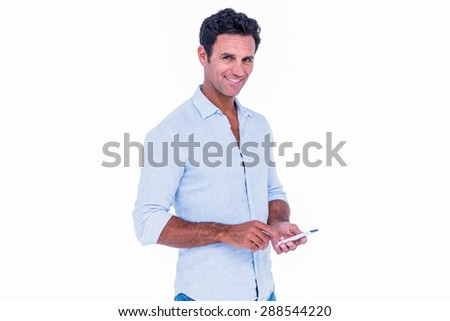 Handsome man using his smartphone on white background
