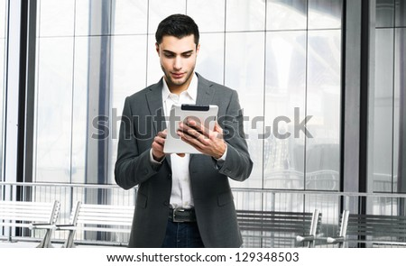 Handsome man using his tablet computer