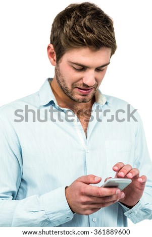 Handsome man using smartphone on white background