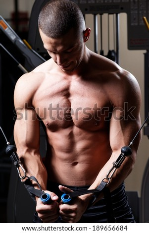 Handsome man.Very power athletic guy Shallow depth of field with focus on abdominals.