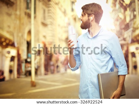 Handsome man walking around in the city - stock photo