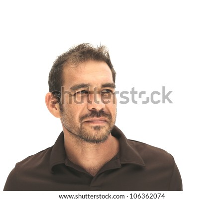 handsome man wearing brown shirt looking off into distance - stock photo
