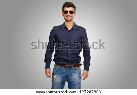 Handsome man wearing shirt against a grey background