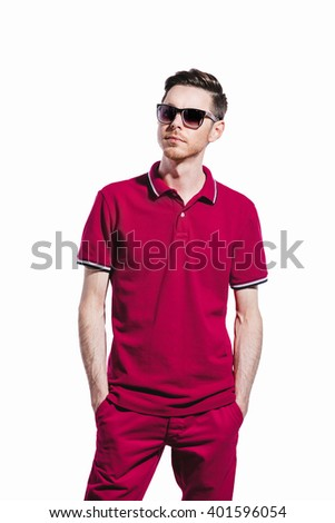 Handsome man wearing styled sunglasses and marsala clothes, shirt, jeans. on White. Direct trendy light.