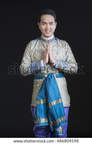 handsome man wearing typical thai dress with black background, identity culture of thailand