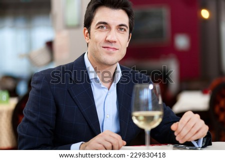 Handsome man with a glass of wine - stock photo