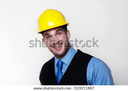 handsome man with a  hardhat looking at camera