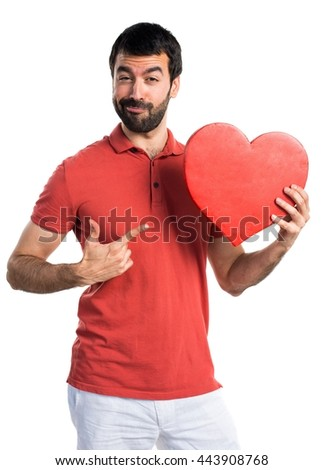 Handsome man with a heart icon - stock photo