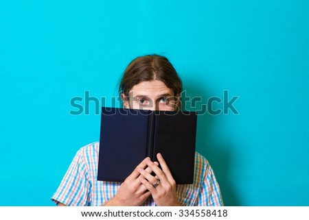 handsome man with a notebook or diary - stock photo