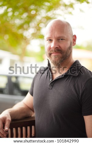 Handsome man with a shaved head - stock photo