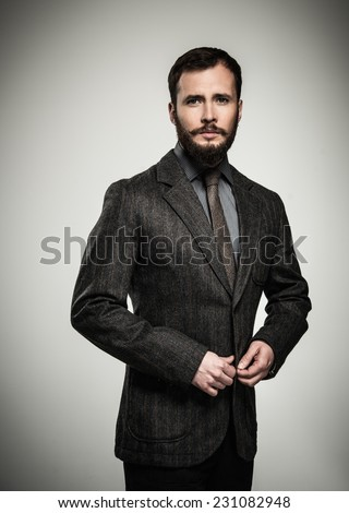 Handsome man with beard wearing jacket  - stock photo