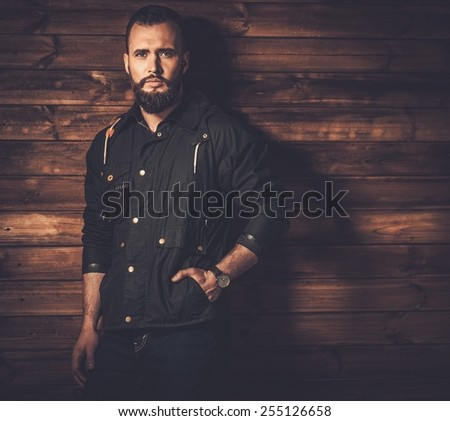 Handsome man with beard  wearing waxed canvas jacket  - stock photo