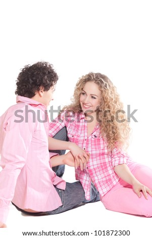 handsome man with beautiful woman in studio - stock photo