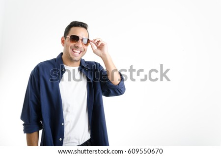 Handsome man with blue shirt wearing glasses