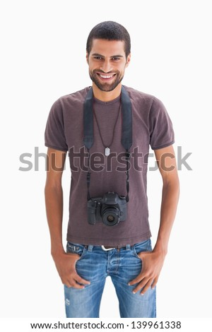 Handsome man with camera around his neck on white background - stock photo