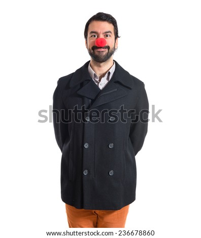 Handsome man with clown nose - stock photo