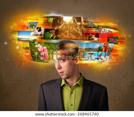 Handsome man with colorful glowing photo memories concept - stock photo