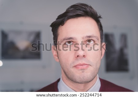 Handsome man with cool hair, looking up - stock photo