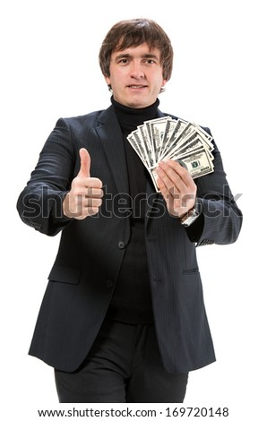 Handsome man with dollar cash money on a white background - stock photo