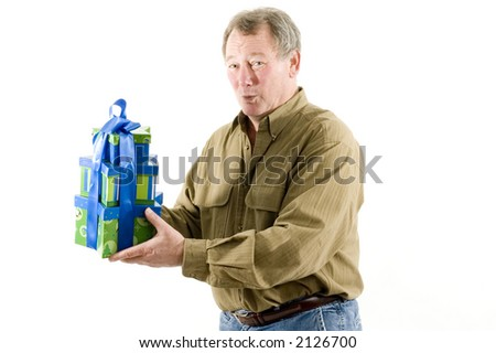 handsome man with gift wrapped presents smiling - stock photo