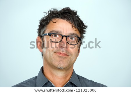handsome man with glasses is looking friendly - stock photo