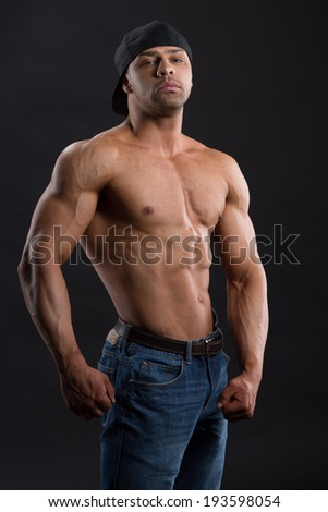 Handsome man with great body posing in the studio