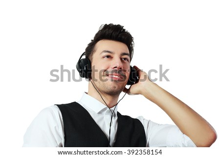 Handsome man with headphones close up portrait isolated - stock photo