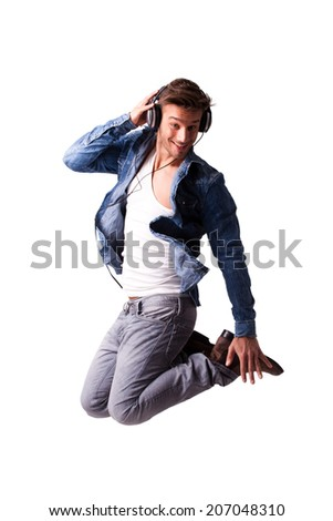handsome man with headphones jumping - stock photo