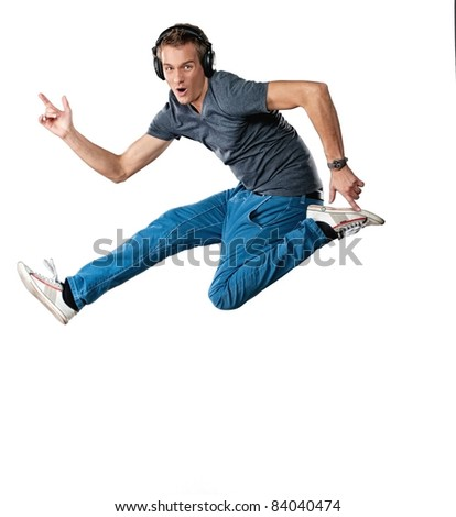 Handsome man with headphones jumping.