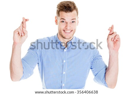 Handsome man with his fingers crossing - stock photo