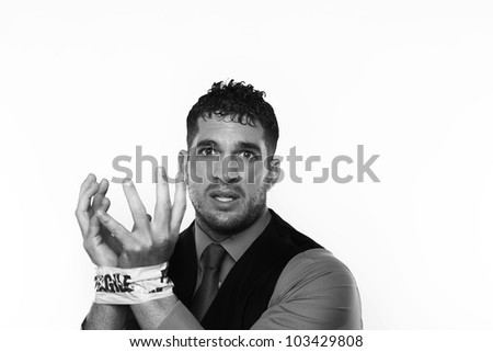 handsome man with his wrist taped up with fragile tape so he cant do any work and in need od some help