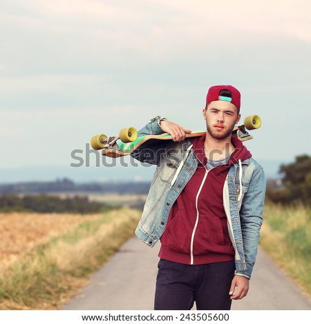 handsome man with longboard - stock photo