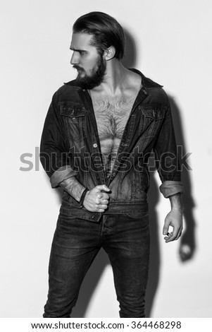 Handsome Man With Perfect Body Posing On Gray Background