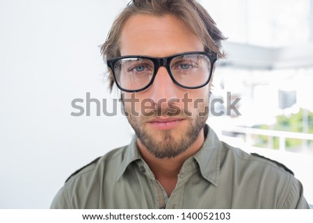 Handsome man with reading glasses looking at the camera