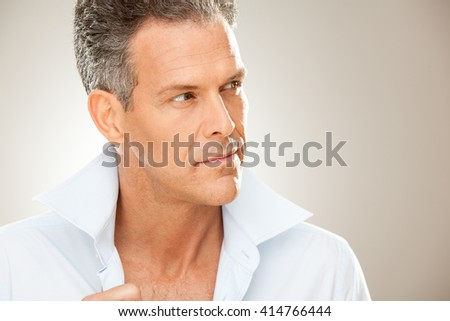 handsome man with shirt portrait isolated on grey
