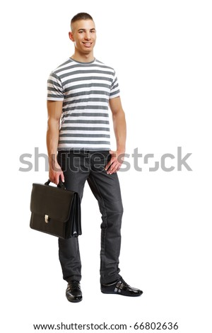 handsome man with suitcase in studio - stock photo