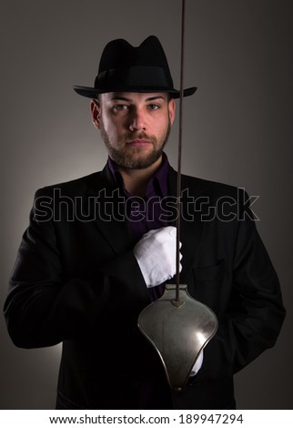 Handsome man with sword fencing and white gloves