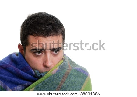 Handsome man wrapped in a warm blanket, isolated on white - stock photo