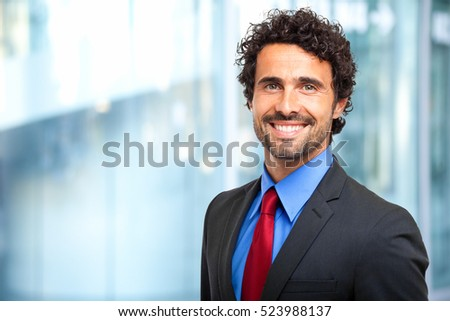 Handsome manager against blurry background