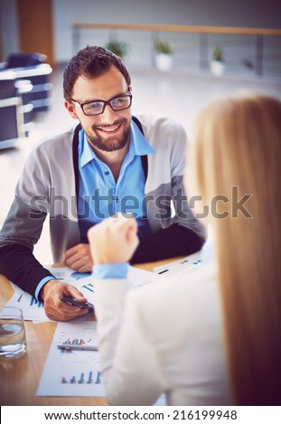 Handsome manager recruiting new workers in office  - stock photo