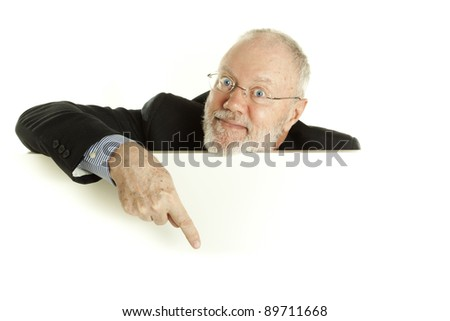 Handsome mature business man pointing finger on blank banner on white background