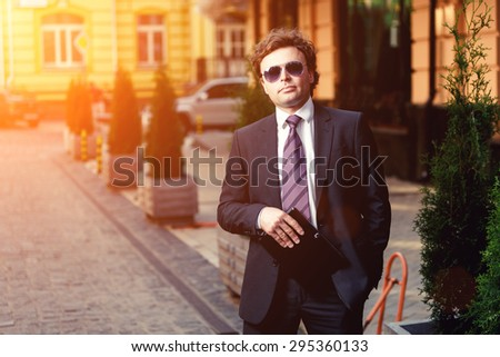 Handsome mature caucasian businessman outdoor wearing suit