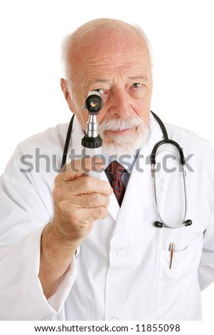 Handsome mature doctor examines you with his otoscope.  Isolated on white. - stock photo