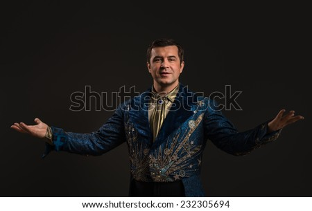 Handsome mature illusionist or wizard or magician conjuring  - stock photo