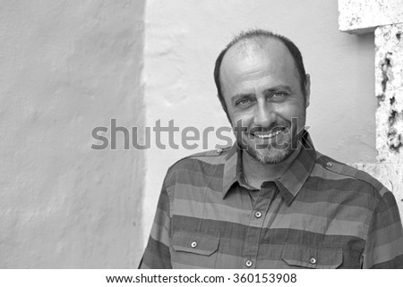 handsome mature man black and white portrait - stock photo